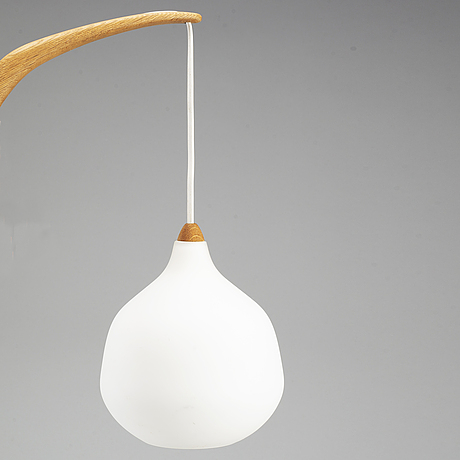 A luxus teak and glass wall light.