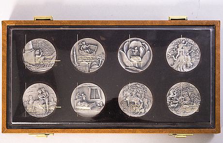 An 8-piece set of h.c. andersen 'the fairy tale series' sterling silver medallions by harold salomon. in original case.
