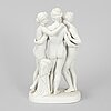 A porcelain figurine, three graces.