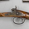 A cased double barreled percussion shotgun marked gosset a paris and a pair of percussion pistols marked fni par lepage.