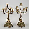 A set of table clock and a pair of candelabra, japy frères, louis xv-style, early 20th century.