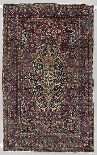 A rug, an antique/a semi-antique esfahan, ca 226 x 143,5-144,5 cm.