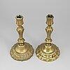 A pair of 18th century bronze candlesticks.