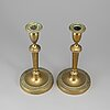 A pair of late 18th century bronze candlesticks.