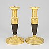 A pair of empire, ormolu candlesticks, first half of the 19th century.