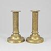 A pair of louis seize bronze candlesticks.