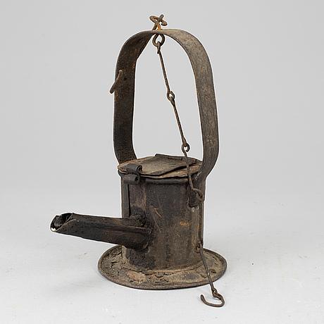 A 19th century tinplate oil lamp.