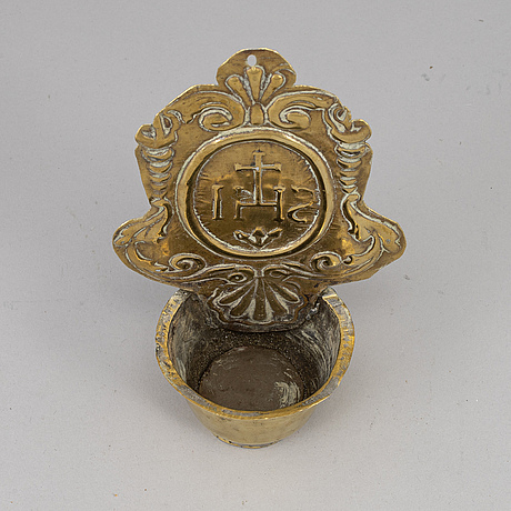 An 18th century brass holy water bowl.