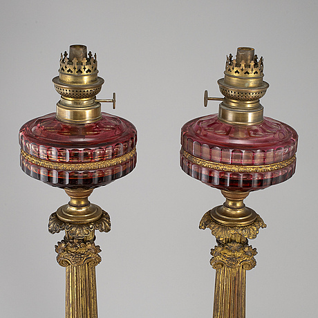 A pair of empire style table oil lamps, bronzed metal and glass, dublot freres, rennes, late 19th century.