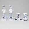 Royal copenhagen, two pairs of porcelaine 'musselmalet' candlesticks. 1963 and 1965.