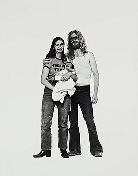 """1053. Elliott Erwitt, """"Hippie Couple and Child, Corning, New York"""", circa 1969."""