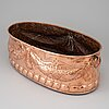 A copper flower pot from the late 1800's.