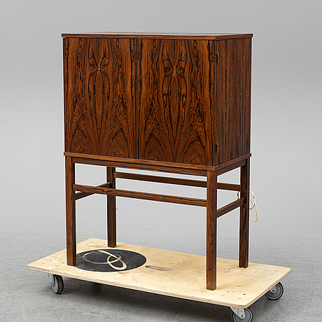 A rosewood veneered drins cabinet, mid 20th century.