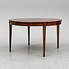 A gustavian style dining table, mid 20th century. four leaves included.