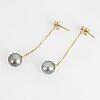 A pair of cultured tahiti pearl and brilliant-cut diamond earrings.
