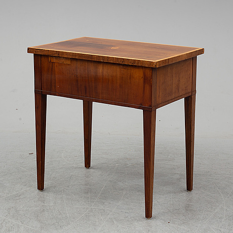 A gustavian sewing table veneered in mahogany.
