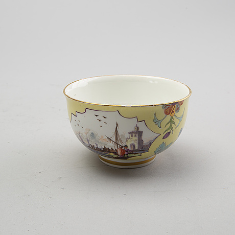A meissen cup with stand and a small jug, 19th century.