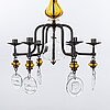 Erik hÖglund,a pair of wall candle holders and a chandelier, kosta boda, second half of the 20th century.