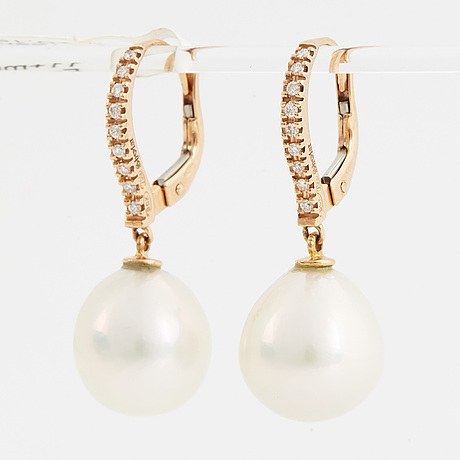 A pair of earrings with cultured freshwater pearl and brilliant-cut diamond.