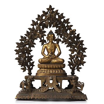655. A large Nepalese gilt bronze buddha on a throne with mandorla, 18/19th Century.