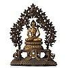 A large nepalese gilt bronze buddha on a throne with mandorla, 18/19th century.