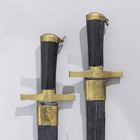 Two swedish cutlasses m/1748-1856, m/1757-1856 samt m/1856 pattern with scabbards.
