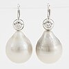 A pair of cultured tahiti pearl and brilliant-cut diamond earrings.