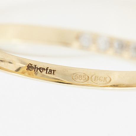A drop shaped yellow diamond and brilliant-cut diamond ring.