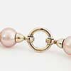 A cultured pink freshwater pearl necklace.