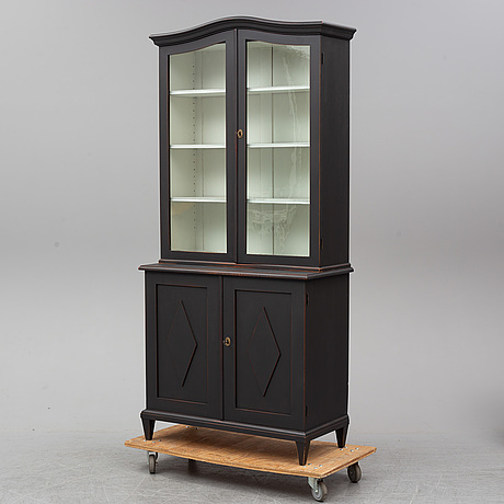 An early 20th century painted display cabinet.