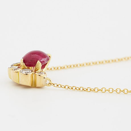 A cabochon-cut ruby and brilliant-cut diamond necklace.
