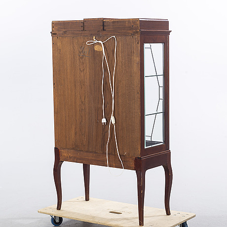 A display cabinet, mid 20th century.