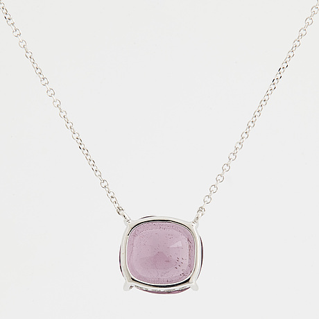 A cushion shaped faceted purple spinel necklace.