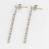Briliant-cut diamond line earrings.