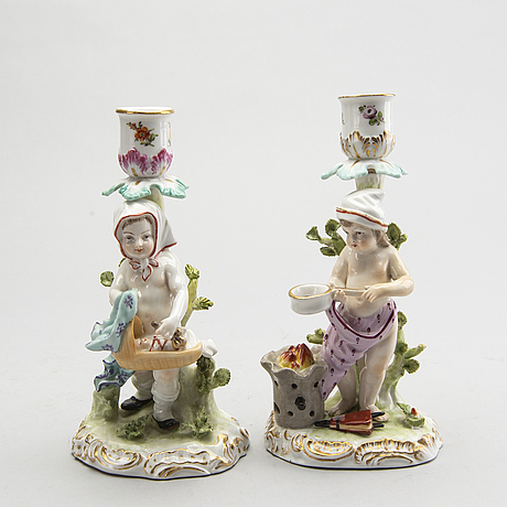 Candlesticks, a pair, figures early 20th century.