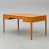 A mid 20th century walnut veneered writing desk by carl malmsten.