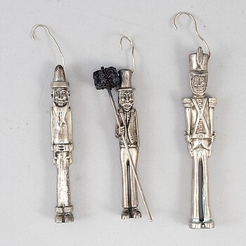 A set of three sterling figures.