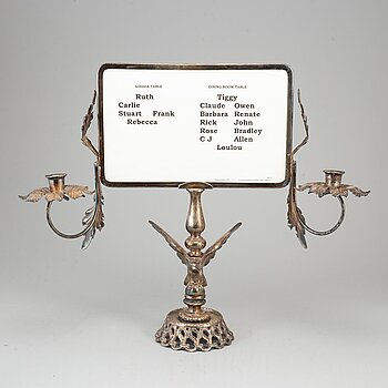 A plated candelabra with table setting card. Rococo-style.