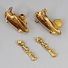 A pair of 14ct gold salt-cellars and spoons, unmarked.