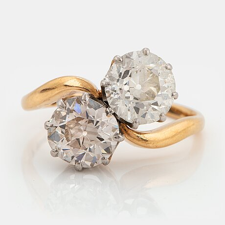 An 18k gold ring set with two old-cut diamonds with a total weight of ca 3.10 cts quality ca j/k si.