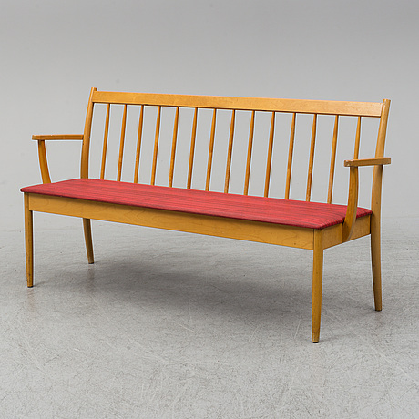 A wooden sofa from the middle of the 20th century.