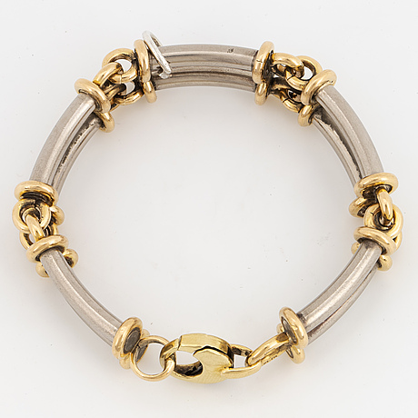 An 18k gold and white gold bracelet.