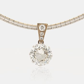 931. A platinum and 14K white gold pendant set with an old-cut diamond weight ca 3.00 cts quality ca K/L vs.