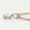 A platinum and 14k white gold pendant set with an old-cut diamond weight ca 3.00 cts quality ca k/l vs.