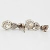A pair of platinum earrings set with cushion formed old-cut diamonds with a total weight of ca 6.00 cts quality ca l/m v.
