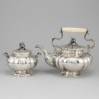 A silver teapot and sugar bowl, maker's mark of Carl Bojanowski, St. Petersburg 1851-57.