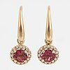 A pair of pink tourmaline and brilliant-cut diamond earrings.