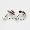 A pair of 18k white gold wa bolin earrings set with faceted rubies and round brilliant- and eight-cut diamonds.