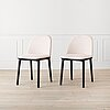 A pair of 'softshell chairs' by ronan & erwan bouroullec for vitra.
