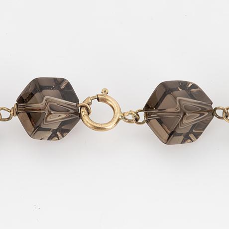 Cube and dropshaped briolette-cut smoky quartz necklace.